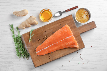 Fresh salmon fillet and ingredients for marinade on table