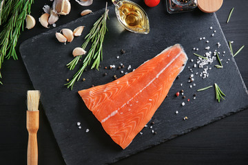Composition with salmon fillet and ingredients for marinade on table