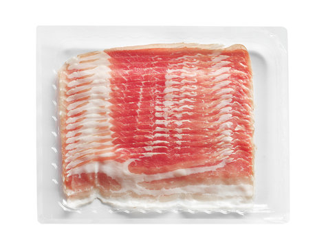 Raw rashers of bacon in package, isolated on white