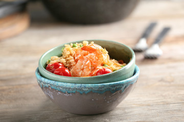 Bowls with delicious shrimp fried rice on table