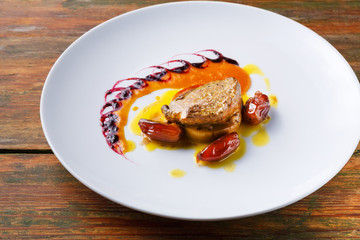 Roasted goose liver with date fruit and apple