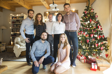 Portrait of family at Christmas tree