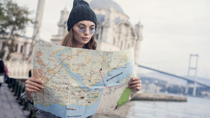 Young tourist woman hand map in outdoors