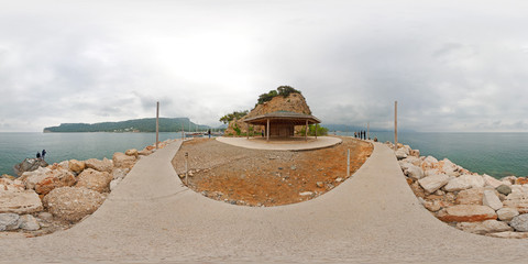 360 degree spherical panorama from Turkey, Antalya, Kemer. Cape of Yoruk park. Seascape with alcove, seafront, stones, fisherman, sea, clouds, mountains, hills. Hdri map
