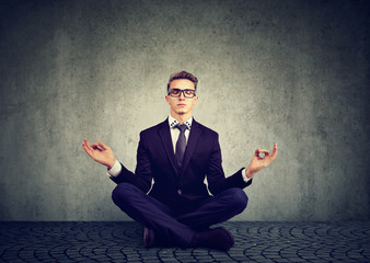 Business man meditating relaxing with eyes closed
