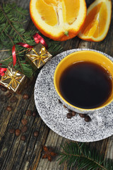 New Year drink: сup of coffee,  orange and Christmas-tree decorations