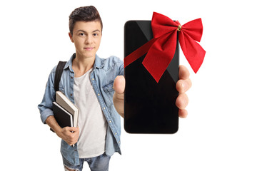 Teenage student showing a phone wrapped with red ribbon as a gift