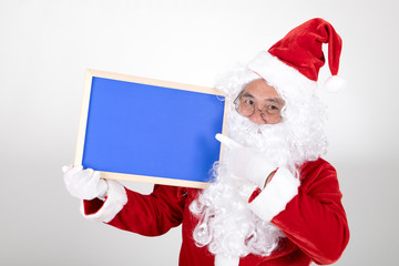 Santa claus holding blue billboard in hand on white background
