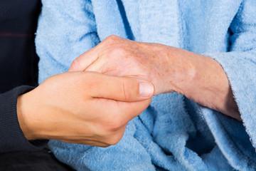Wrinkled senior hands