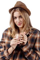 Pretty blonde with mug on white background.