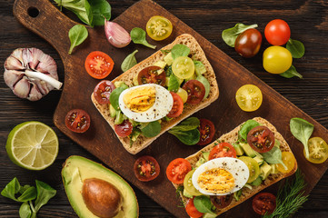 Bruschetta with avocado, egg and tomatoes.