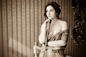 Young Lady with pale skin plus size in vintage pin up retro style at cozy home. Pretty casual retro style 40-5 years for xl size woman