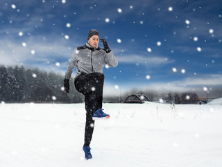 man exercising and warmig up in winter outdoors