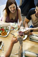 Friends clinking glasses in restaurant