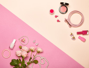 Fashionable Women's Cosmetics and Accessories. Falt Lay. Nail Polish and blush. Jewelry and Rings. A bouquet of flowers. Pink roses
