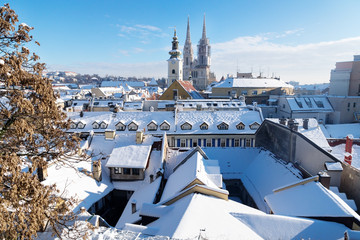 View over Zagreb during winter with snow with view to towers of church and cathedral at a sunny day, Zagreb, Croatia, Europe