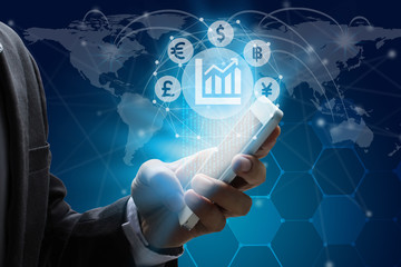 Businessman use smartphone with Currencies sign symbol of Fintech over the Network connection of World map on technology background, Investment Financial Technology Concept