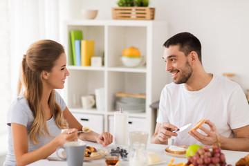 happy couple having breakfast at home