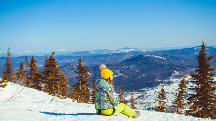 the girl sits on top in winter