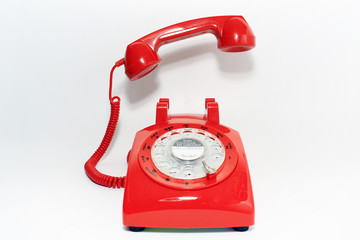Retro rotary dial phone on call with no body, hang up by hollow man