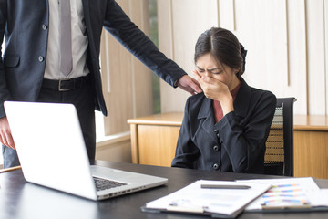Desperate young Asian businesswoman unable to work with stress situation, suffering stress, boss come to order many job to her, Woman in Stress situation Concept.