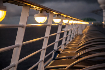 Cruise ship sunbeds by lamp light