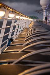 Cruise ship sunbeds by lamp light, portrait