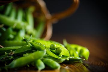 Fresh early green peas in a basket