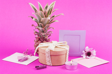 Pink pineapple, empty frames on pink