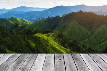 wooden floor terrace or plank desk with beautiful sunset in the mountain, landscape nature...