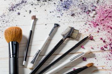 Closeup of professional makeup accessories with brushes and colors