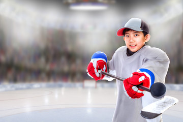 Junior Hockey Player Posing in Arena With Stick Balancing Puck