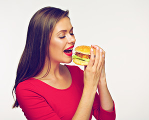 Woman eating burger. Isolated portrait on white