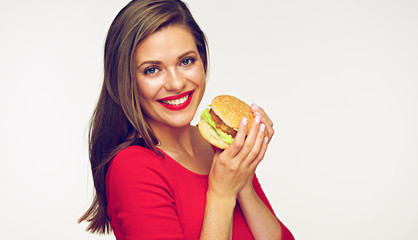 Smiling woman wearing red dress holding burger.