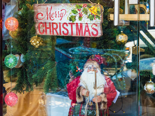 Showcase of Christmas toys and Santa Claus dolls store