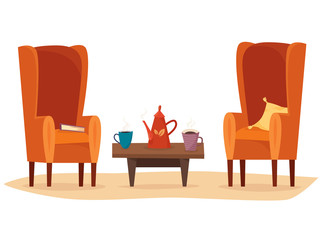 Chairs and table with cups of tea or coffee, teapot, pillow and book.
