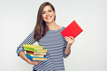 Beautiful girl holding pile of books.