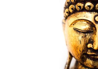 head of golden buddha statue on white background