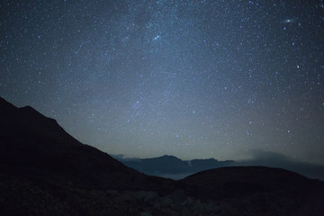 night landscape in the mountains. Starry sky