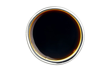 Soy sauce in the small glass bowl. Isolated