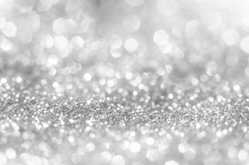 Abstract of Bright and sparkling bokeh background. silver and diamond dust bokeh blurred lighting from glitter texture Wall mural