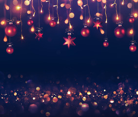 Balls And Christmas Lights Hanging On Dark Background
