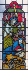 LONDON, GREAT BRITAIN - SEPTEMBER 19, 2017: The Nativity on the stained glass in St Mary Abbot's church on Kensington High Street.