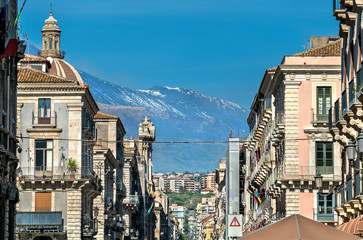 View of the historic centre of Catania with Etna Volcano in the background. Italy, Sicily