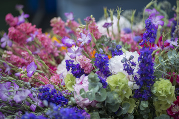 Display of colorful flower bouquets at a farmers market