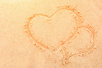 photo two hearts painted on the sea sand on the shore close-up