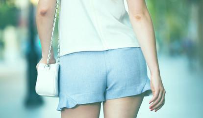 Female buttocks in blue shorts