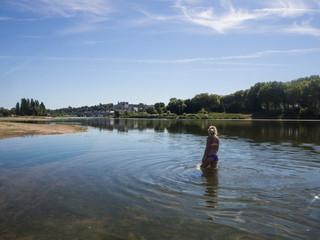 Blonde Girl bathing in the river Loire, France