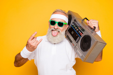 Cheerful excited aged funny active sexy athlete cool pensioner grandpa in eyewear with bass clipping ghetto blaster recorder. Old school, swag, sticking tongue, fooling, gym, workout, technology Fototapete