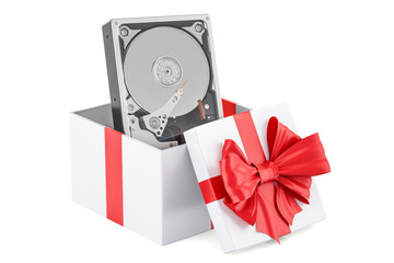 Hard Disk Drive (HDD) inside gift box, gift concept. 3D rendering